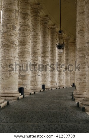 The Colonnade located in the front of the St. Peter's Basilica (Basilica di San Pietro) in Vatican, Rome,  Italy. The columns are surrounding the famous Saint Peter's Square (Piazza San Pietro)