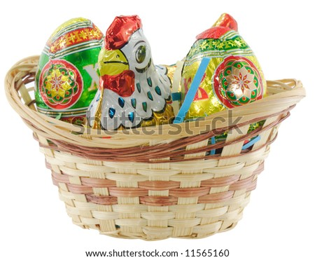 The color easter eggs and chicken in basket