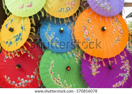 The color of umbrella on the market. Colorful handmade umbrella's. - stock photo