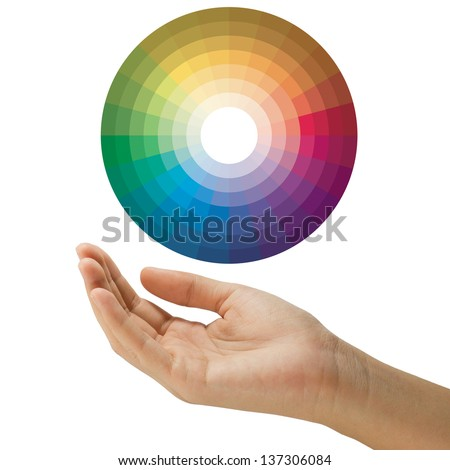 the color wheel circle floating above empty hand isolated on white background - stock photo