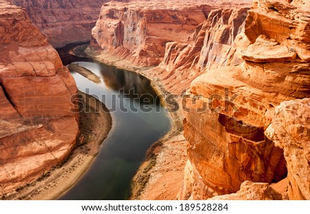 The Colorado River Meanders Cutting into What Becomes the Grand Canyon - stock photo