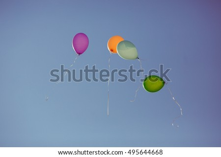 The colored balloons flying  to sky