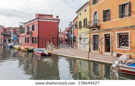 The colored houses on the shore of a channel - Burano, Venice, Italy