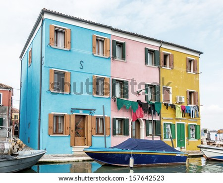 The colored houses on the shore of the channel on the island of Burano - Venice, Italy