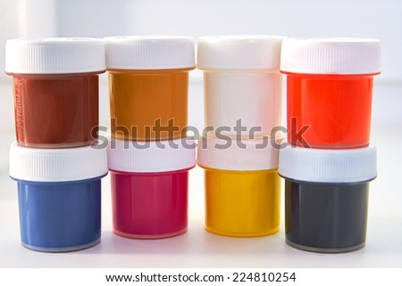 The colored paint bucket CMYK - stock photo
