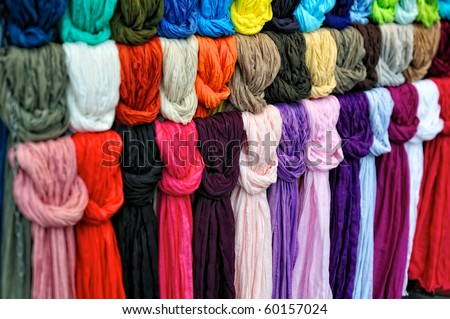 The colored silk scarfs in rows in market