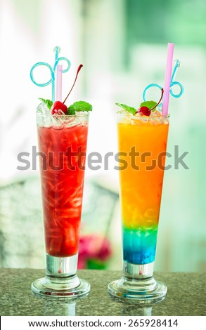 The colorful alcohol cocktail with red cherry and peppermint