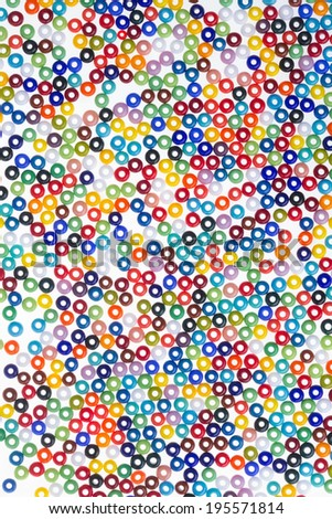 The colorful beads  on white background