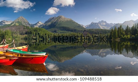 The colorful boats on Strbske lake - Slovakia - stock photo