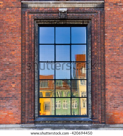 The colorful buildings of Nyhavn, Copenhagen reflected in a window - stock photo