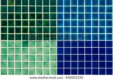 The colorful clay ceramic  tiles with glazed surface (coating) Green,Dark Green,light blue and dark blue color, products of the northern Thailand  - stock photo