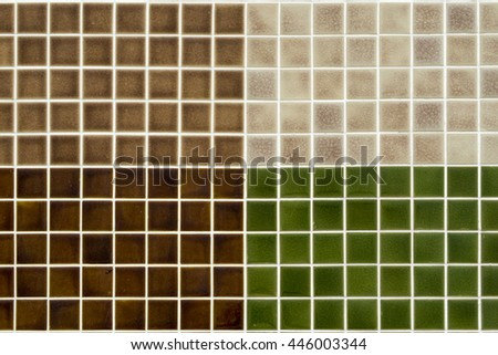 The colorful clay ceramic  tiles with glazed surface (coating) in Brown,Dark brown,Cream and Green color, products of the northern Thailand  - stock photo