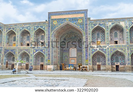 The colorful courtyard of Sher-Dor Madrasah is the best place to relax, drink the Uzbek tea and enjoy the beautiful mosaic traceries, Samarkand, Uzbekistan.