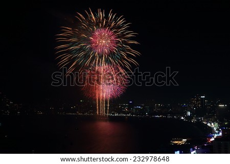 The colorful firework during international fireworks festival 2013 at PATTAYA City in Thailand. - stock photo
