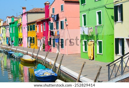 The colorful houses along the canal in the island of Burano, Italy