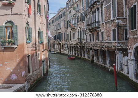 The colorful houses in water canal, Landmark of Veneto region. Venice, Italy. - stock photo