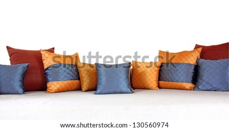 The colorful pillows scattered on the table. - stock photo