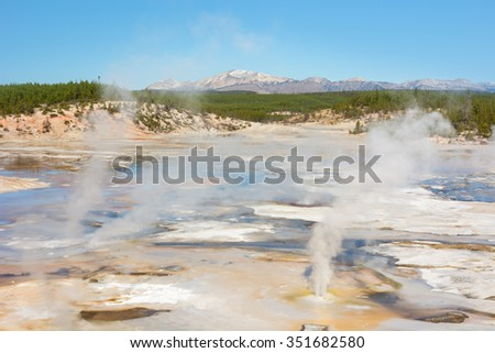 The colorful Porcelain Basin in the Norris Geyser Basin of Yellowstone National Park Wyoming. Mt Holmes on the horizon. - stock photo