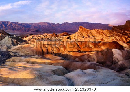 The Colorful Ridges Of Zabriskie Point At Sunrise, Death Valley National Park, California, USA - stock photo