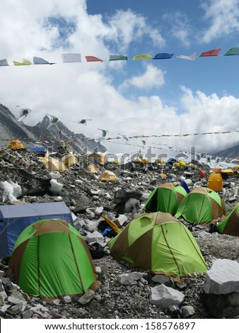 The colorful tents of Everest Base Camp dot the landscape at the foot of Mount Everest in Nepal.