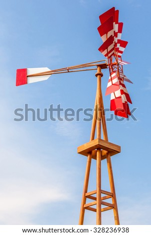The colorful weathervane over the blue sky background. - stock photo