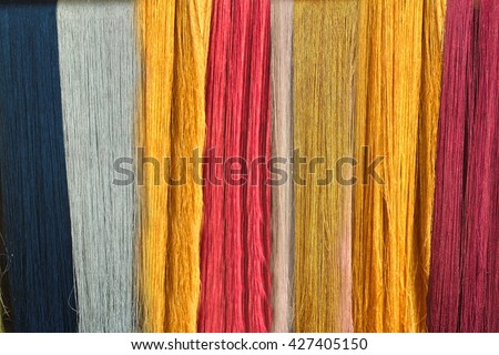 The colorful Weaving loom and the silk  - stock photo