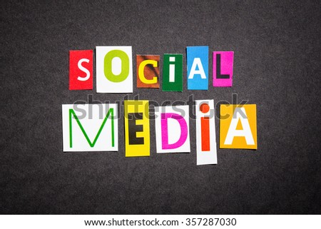 The colorful word social media in cut out magazine letters. - stock photo