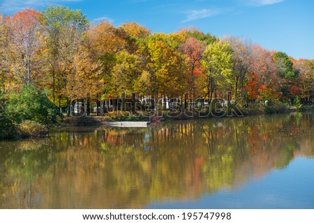 The colors of the fall reflecting in a river, Quebec, Canada - stock photo