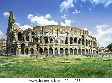 The Colosseum in Rome. Green grass - stock photo