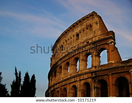 The colosseum in rome, with blue sky