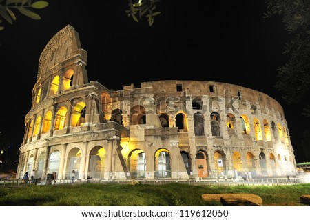 The Colosseum, the most famous monument of ancient Rome that has become an icon of architecture and civilization of imperial Rome. Night view. Rome (Italy) - stock photo