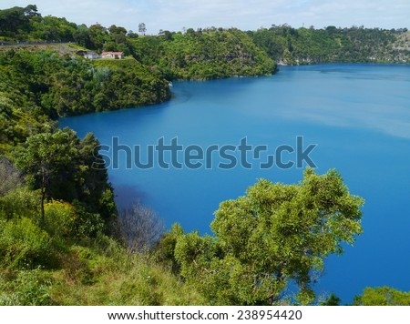 The colour of the blue lake in Mouint Gambier changes dramatically from grey to vivid blue over a few days in november each year - stock photo