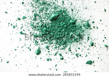 The colour of the year 2013, Emerald green crumbled pastel chalk close-up composition on white paper background - stock photo