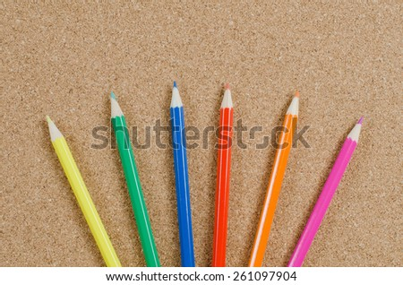 The colour pencils on �orkboard. School concept - stock photo