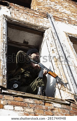 The combat aims out of the window - stock photo
