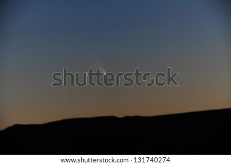 The comet Panstarrs sets over the desert near Belen New Mexico. Captured March 12, 2013. - stock photo