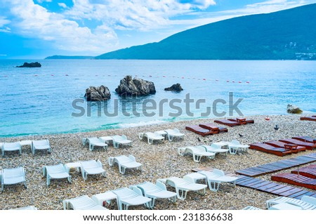 The comfortable sun beds on the central beach wait for the tourists, Herceg Novi, Montenegro.