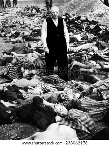 The commandant of the concentration camp in Landsberg Germany stands amid some of the prisoners that were shot or burned as American soldiers approached 1945 - stock photo