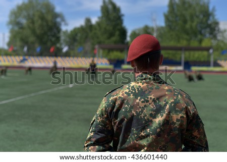 The commander of the military unit observes the performance of their soldiers - stock photo