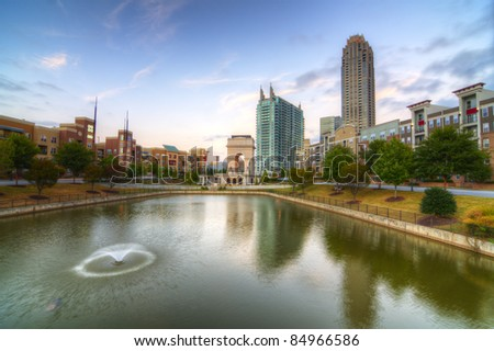 The commons and pond at Atlantic Station in Atlanta, Georgia, USA. - stock photo