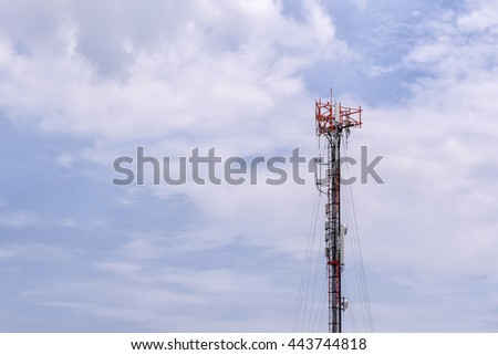 The communication antenna tower building with the blue sky.