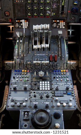The complex throttle controls in a 747 jumbo-jet cockpit.