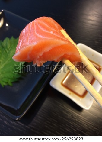 The composition of nigiri sushi with salmon on rice