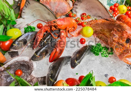 The composition of seafood and greens, and ice