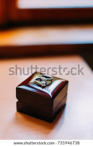 The composition of the jewellery boxes with silver wedding rings.