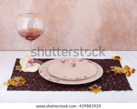 The composition of the kitchen utensils. Glass of wine on a table with a vintage background - stock photo