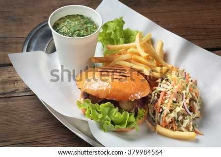 the composition of the lunch kit with burgers, soup and salad - stock photo