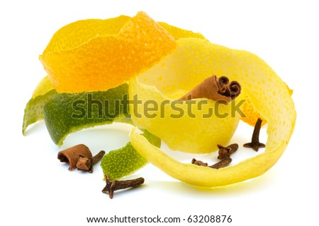 The composition of the pieces of lemon peel, orange, lime with cinnamon and cloves. Close-up. Isolated on white background.