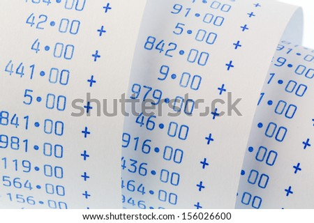 the computational stripes of a calculator on a white background. symbolic photo for controlling, accounting, taxation and finance - stock photo