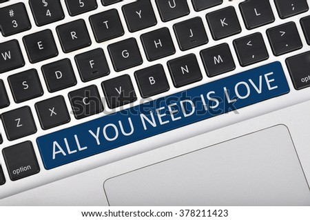 The computer keyboard button written word all you need is love .